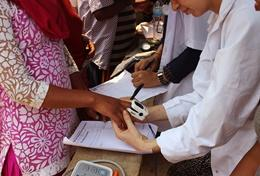 A young boy is assisted on the Medical School Elective in Nepal.