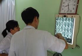 A Medical School Elective volunteer and supervisor check a patient's x-rays in Vietnam.