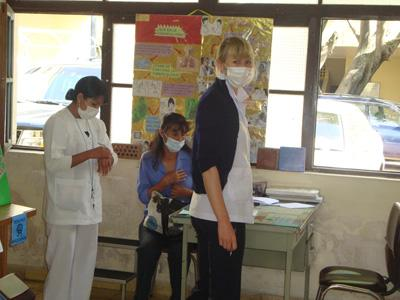 Nursing student works with local staff in a nursing unit in Bolivia