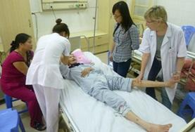 Nursing interns in Vietnam assist staff with treating a patient on the Nursing School Elective.