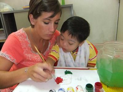 Occupational Therapy Student works on arts project with a child on an Elective placement in Morocco