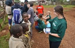 Volunteers on the Pharmacy School Elective in Kenya assist with the distribution of medication during an outreach.