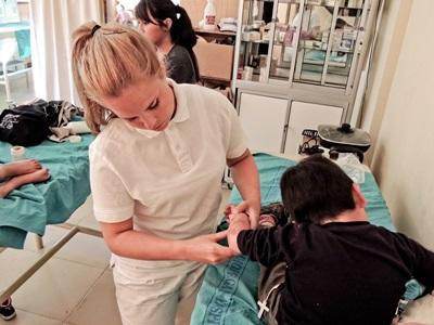 Physical Therapy Elective intern treating a child in Bolivia