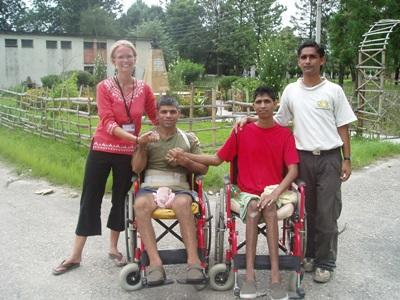 Physical Therapy interns with disabled patients outside of a clinic in Nepal