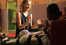 A Physical Therapy Electives volunteer in Bolivia works with boy at her placement in Bolivia
