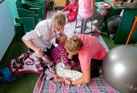 Students on their Physical Therapy Student Elective help a young patient in Morocco.