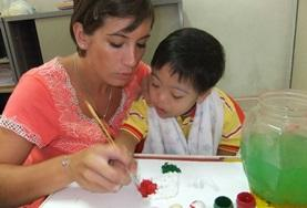 A volunteer on the Occupational Therapy Student Elective Abroad Project works with a child at her placement.
