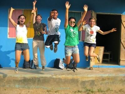 Volunteers at a school they painted during their Global Gap Year Program