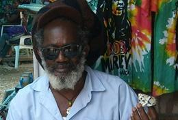 Volunteers speak to a local Rastafarian man in Jamaica on the Rastafarian Project Grown-Up Special.