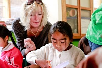 A girl being assisted by a Projects Abroad Teaching volunteer in Peru