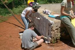 High School Special volunteers in Jamaica on the General Building Project paint a wall at their placement.