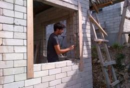 A High School Special volunteer in Philippines works at his Building Project.