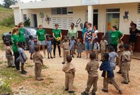 Care & Community High School Special volunteers in Jamaica play a game with primary school students.