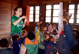 Children make fun masks with Care & Community High School Special volunteers in Madagascar.