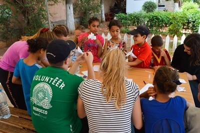 Moroccan children participate in an arts and crafts session with Projects Abroad High School Special volunteers.