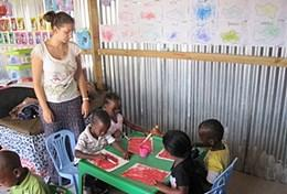 High school volunteers with children at the Care & Community Project in South Africa.