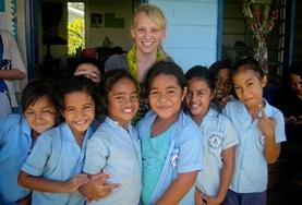 A Care & Community Village Project High School Special volunteer with her students in Samoa.