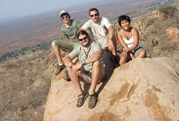 Volunteers on the High School Special Conservation Project in Southern Africa observe animals from a viewpoint.