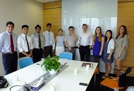 High School Special volunteers take a photo with their supervisors at their Law & Business placement in China.