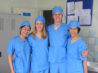 Medicine volunteers dressed in scrubs in a hospital in Mongolia