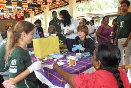 Student volunteers on the Sri Lanka Medicine High School Special assist at an outreach.