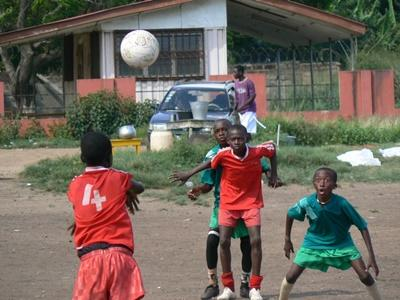 Teen volunteer coached students at a school on a Sports project in Ghana