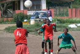 A group of young boys in Ghana play soccer at a placement on the High School Special Sports Project.