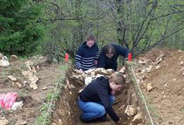 Volunteers on the Archaeology project in Romania dig for findings