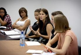 Volunteer Law & Human Rights interns abroad attend their weekly meeting at their placement.