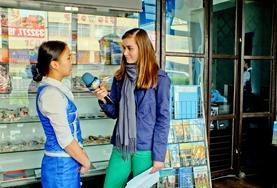 An intern on a Journalism Internship abroad interviews local people for his story in Europe.