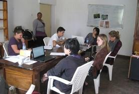 Interns on the Microfinance Internship abroad in Africa work together with local staff to create business plans.