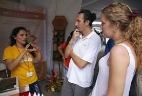 Business interns discuss a strategy with a local entrepeneur on their volunteer project in Costa Rica.