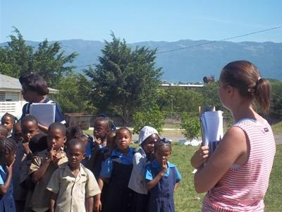 Volunteer works with children affected by natural disasters in Jamaica