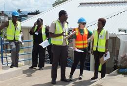 A volunteer on the Disaster Management Project in Jamaica talks to local staff.