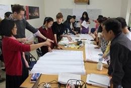 Volunteers on the Vietnam Internationl Development Project brainstorm at their placement.