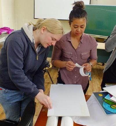 Projects Abroad Social Work interns work together to prepare materials for a workshop in Mongolia, Asia.