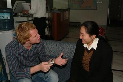 Volunteer and Staff on the journalism project in China have a meeting
