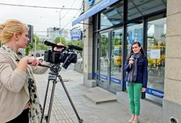 A student on the Intern in Film Production Abroad Project learns how to film video.