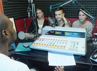Interns on the Radio Journalism project learn how to use the studio equipment in Jamaica