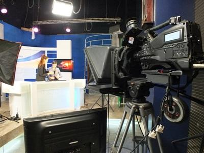 Journalism interns work at a Mongolian television news station