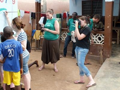 Journalism interns video tape and photograph a community in Togo