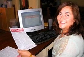 A volunteer on her Journalism Project in Bolivia shows her completed article.