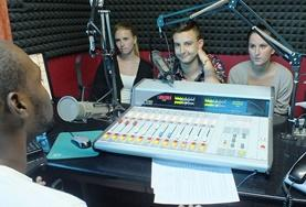 Volunteers on the Journalism Internship in Jamaica learn about broadcast radio from a local DJ.