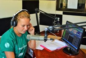 A student on the Philippines Journalism Internship learns how to produce and run a live radio show.
