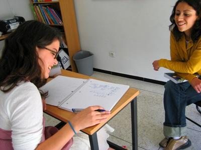 Volunteer works one of one with teacher to learn Arabic