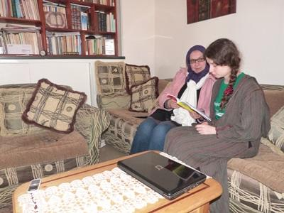 Volunteer practices speaking Arabic with a local in Morocco