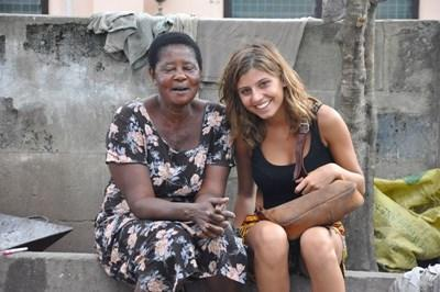 Volunteer learning Twi in Ghana with a local woman