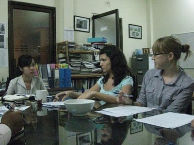 Volunteers on the Human Rights Project in Cambodia work in the office