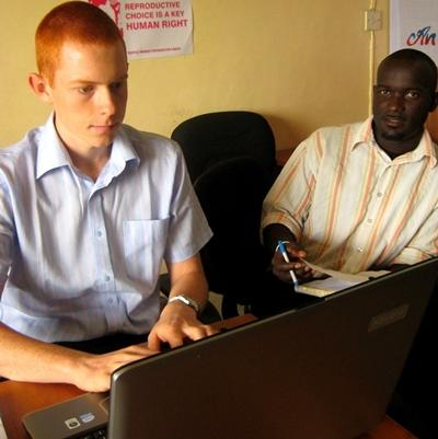 Intern on the Human Rights project in Ghana does office work with staff member