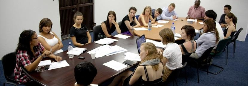 Volunteers on the Human Rights project have a meeting